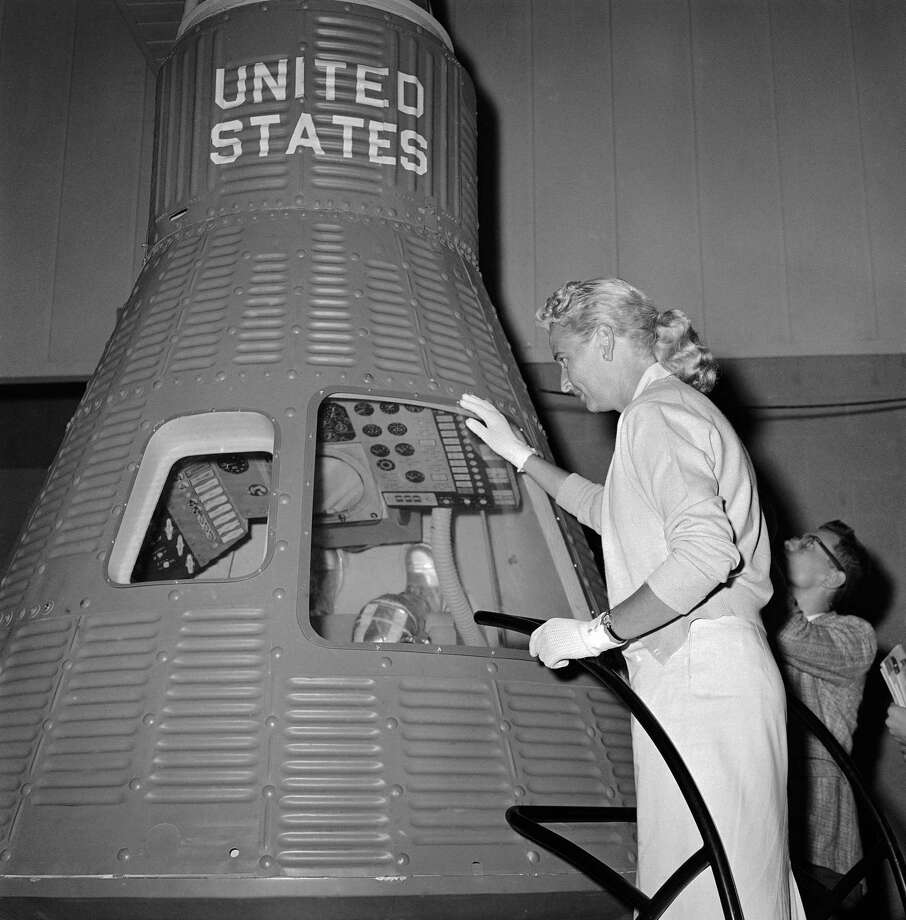 FILE - In this May 26, 1961 file photo, Jerri Cobb looks into a full-scale model of the Mercury capsule which carried Alan Shepard into space, in Tulsa, Okla. Cobb, NASA's first female astronaut candidate, died in Florida at the age of 88 on March 18, 2019. (AP Photo/William P. Straeter) Photo: William P. Straeter / 1961 AP