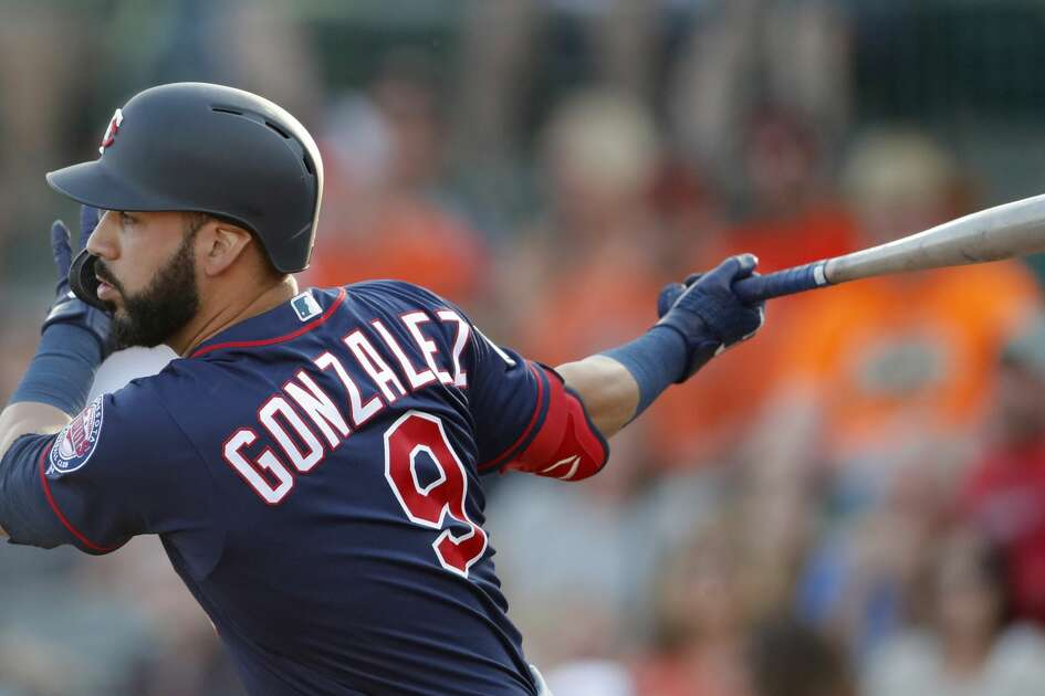Minnesota Twins left fielder Marwin Gonzalez (9) is shown in action against the Baltimore Orioles during a spring training baseball game Saturday, March 23, 2019, in Sarasota, Fla. (AP Photo/John Bazemore)
