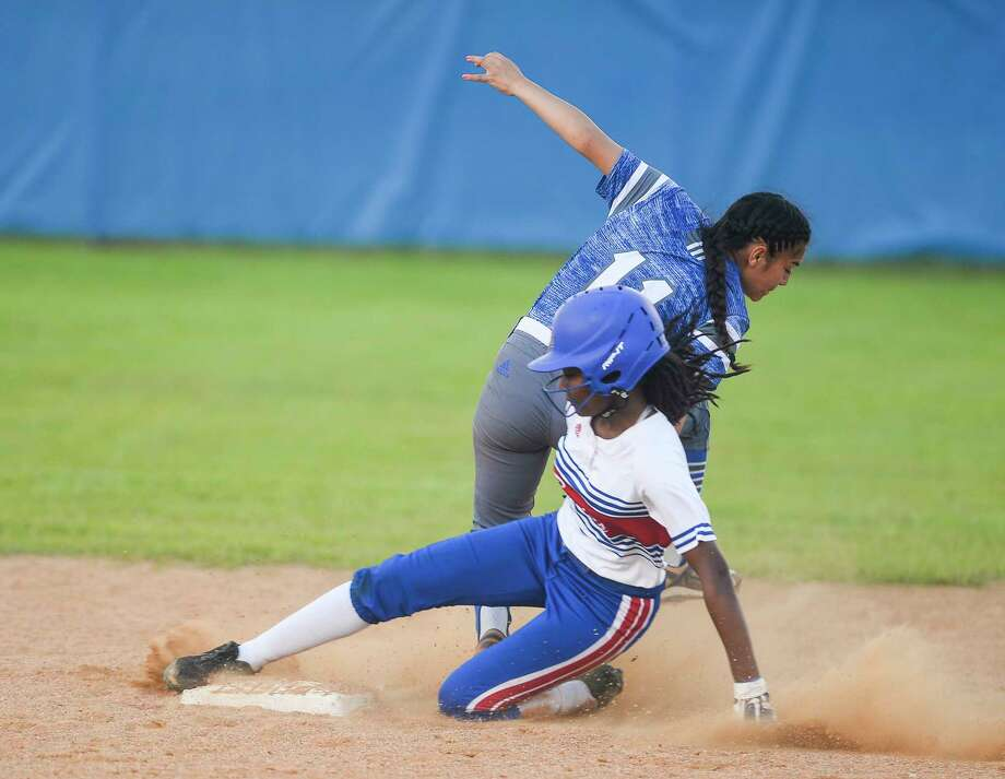 West Brook's Neveah Garrett slides into second base during the game against Baytown Sterling at West Brook High School on Thursday. West Brook fell to Sterling 8-5. Photo taken on Thursday, 04/18/19. Ryan Welch/The Enterprise Photo: Ryan Welch, The Enterprise / © 2019 Beaumont Enterprise