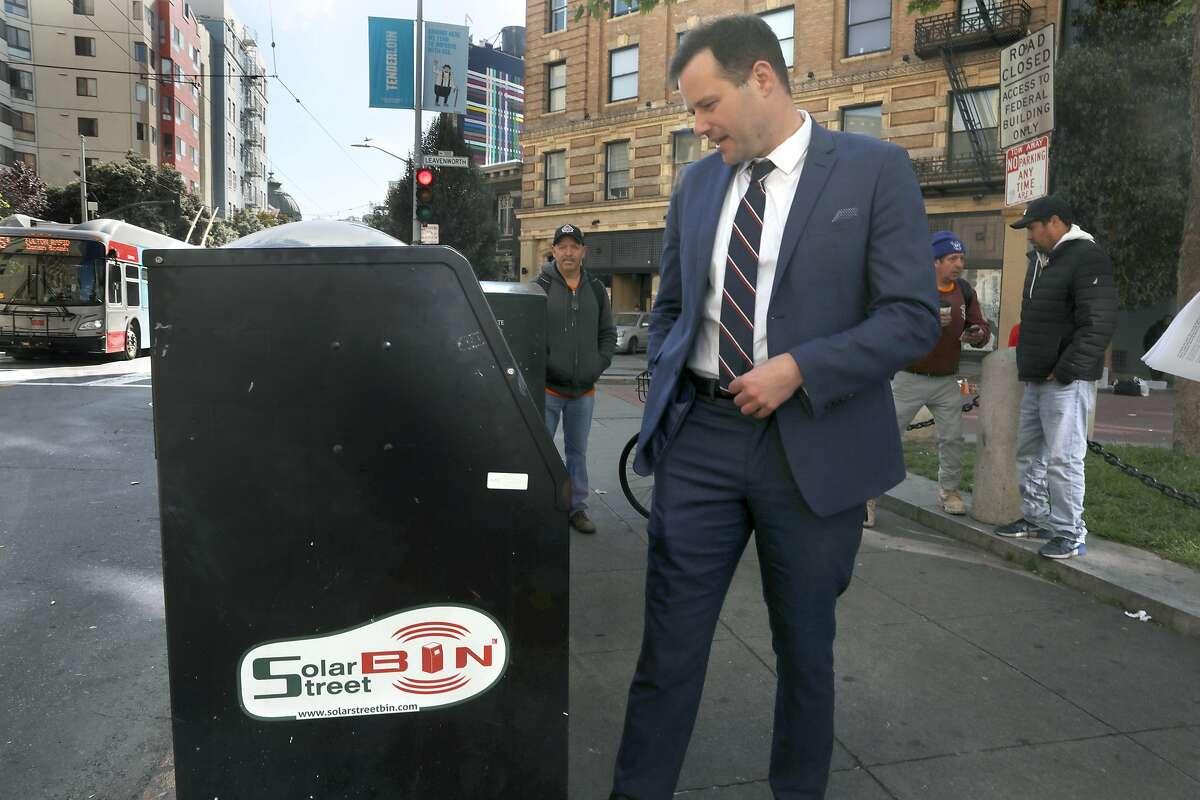 Supervisor Matt Haney shows a solar street bin on Golden Gate Ave. at Leavenworth St. on Wednesday, April 17, 2019 in San Francisco, Calif.