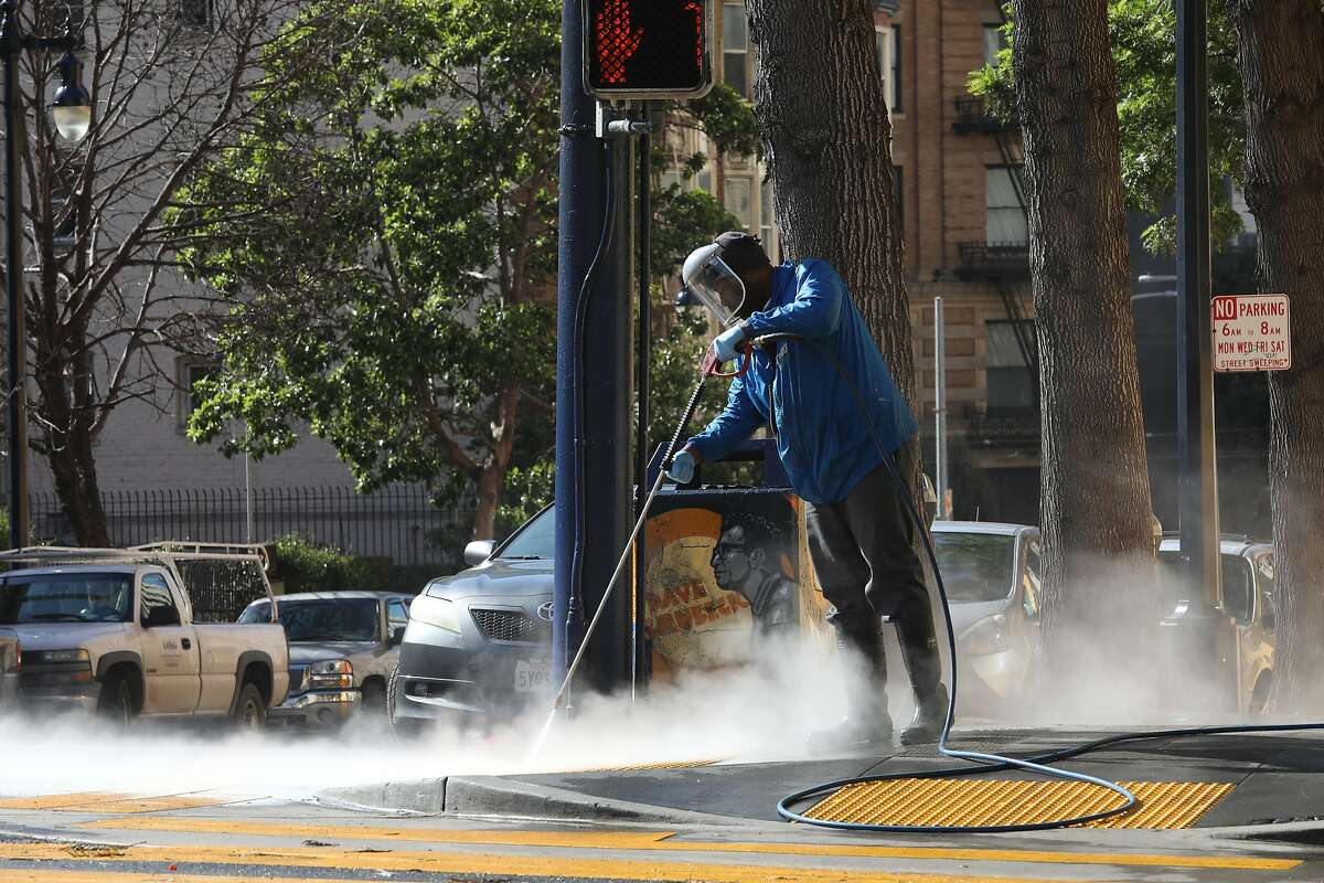 Pressure washing from the Tenderloin Community Benefit District sen on Leavenworth near Turk streets on Wednesday, April 17, 2019, in San Francisco, Calif.
