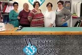 Warm N Cozy Quilting's Julie Yeager, Trish Cyvas, Debbie Chitty, Danielle Cyvas, Sarah Neuman.