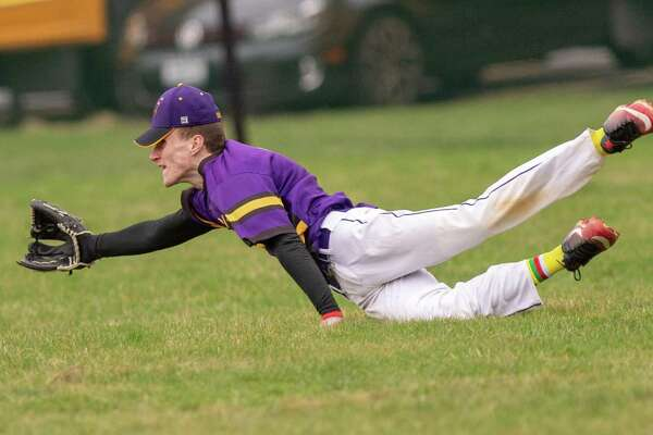 Voorheesville centerfielder Nick Angelo makes a diving try at a fly ball against Mohonasen at Voorheesville High School on Thursday, April 18 2019 (Jim Franco/Special to the Times Union.)