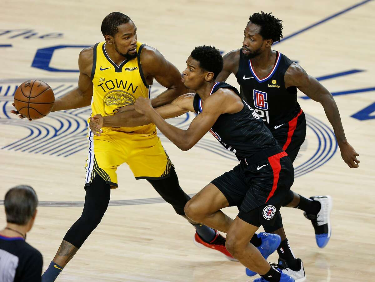 Golden State Warriors Kevin Durant is hounded by Los Angeles Clippers Shai Gilgeous-Alexander and Patrick Beverley in the second quarter during game 2 of the Western Conference Playoffs between the Golden State Warriors and the Los Angeles Clippers at Oracle Arena on Monday, April 15, 2019 in Oakland, Calif.