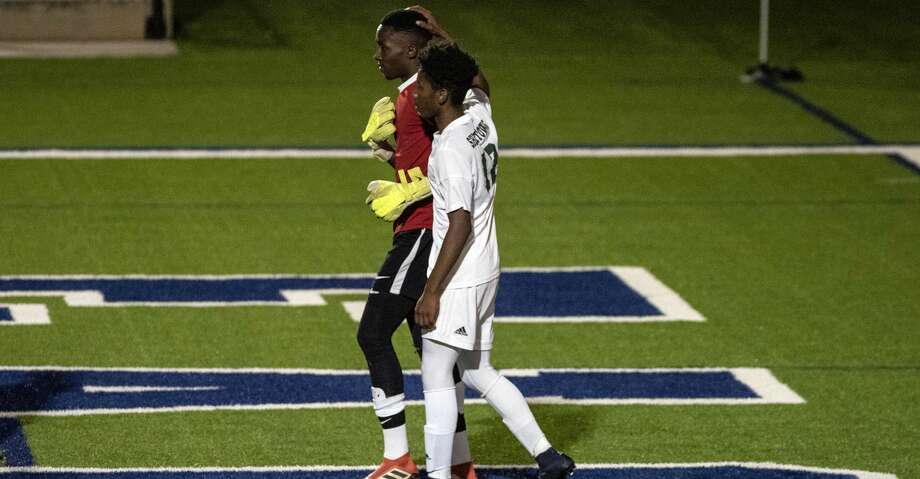 Houston Sharpstown, Blaise Mucho, (68), goalkeeper, is comforted by Jostin Garcia Lagos, (12), after a second goal by Frisco Wakeland got past him during the first half of UIL Boys 5A semifinals soccer game, Thursday April 18,2019, in Georgetown, Texas.  (Rodolfo Gonzalez/Contributor) Photo: Rodolfo Gonzalez/Houston Chronicle
