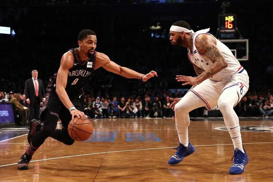 NEW YORK, NEW YORK - APRIL 18: Spencer Dinwiddie #8 of the Brooklyn Nets handles the ball against Mike Scott #1 of the Philadelphia 76ers in the first quarter during game three of Round One of the 2019 NBA Playoffs at Barclays Center on April 18, 2019 in the Brooklyn borough of New York City. NOTE TO USER: User expressly acknowledges and agrees that, by downloading and or using this photograph, User is consenting to the terms and conditions of the Getty Images License Agreement. (Photo by Elsa/Getty Images) Photo: Elsa / 2019 Getty Images
