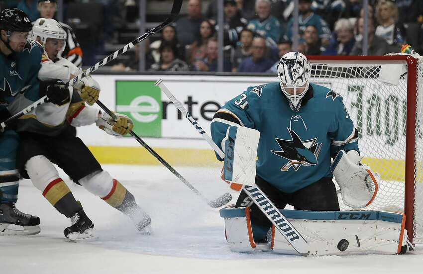 San Jose Sharks goalie Martin Jones, right, blocks a shot from the Vegas Golden Knights during the second period of Game 5 of an NHL hockey first-round playoff series Thursday, April 18, 2019, in San Jose, Calif. (AP Photo/Ben Margot)