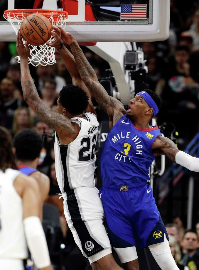 Denver Nuggets forward Torrey Craig (3) fouls San Antonio Spurs forward Rudy Gay (22) as he tries to block the shot during the first half of Game 3 of an NBA basketball playoff series in San Antonio, Thursday, April 18, 2019. (AP Photo/Eric Gay) Photo: Eric Gay / Copyright 2019 The Associated Press. All rights reserved.