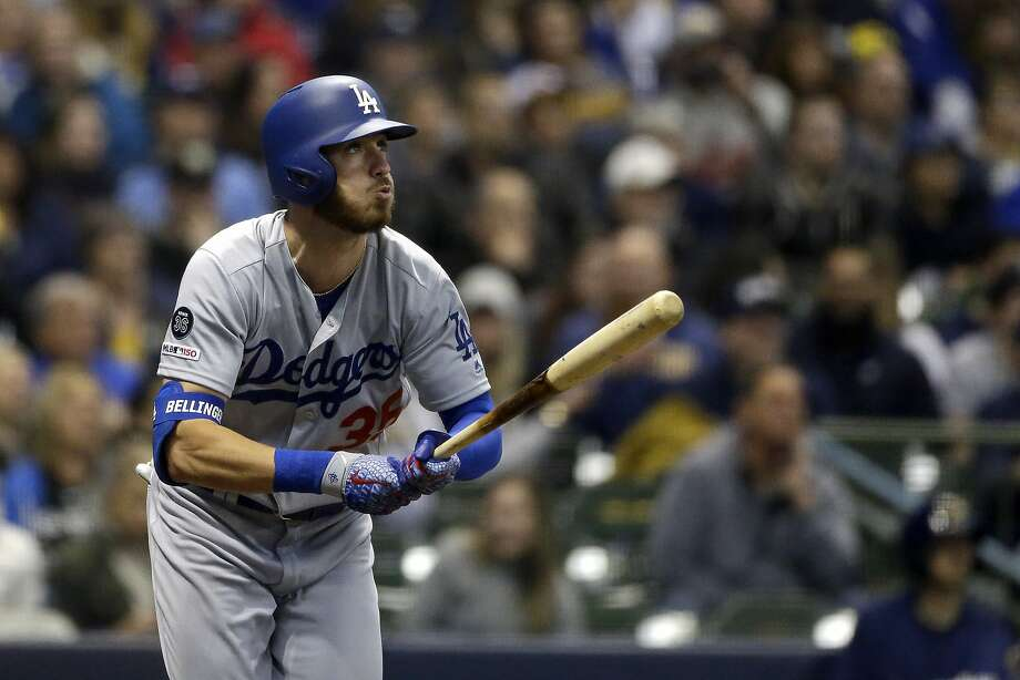 The Dodgers' Cody Bellinger watches his sixth- inning homer sail toward the seats in Milwaukee. Photo: Aaron Gash / Associated Press