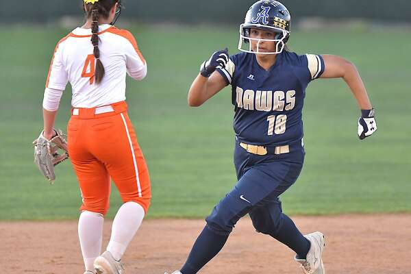 Amanda Flores scored one of 12 runs Thursday as Alexander beat United 12-5 in a rivalry doubleheader at the SAC. In the opening game, LBJ eliminated United South with a 10-9 victory.