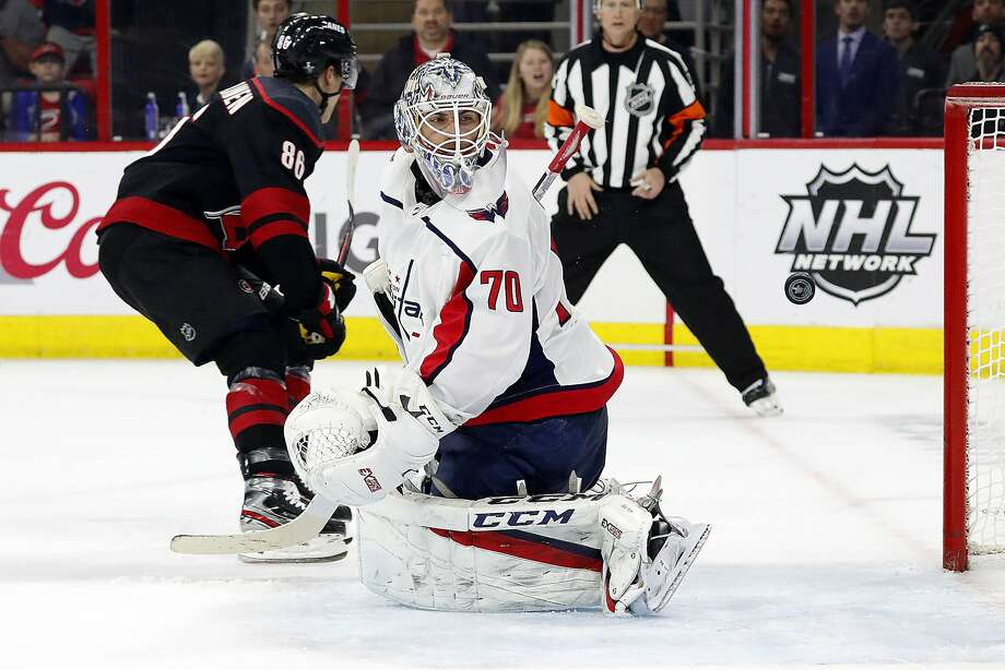 Capitals goaltender Braden Holtby looks back to see that a shot by the Hurricanes' Teuvo Teravainen (86) has gone into the net in the second period. It proved to be the winning goal. Photo: Karl B DeBlaker / Associated Press