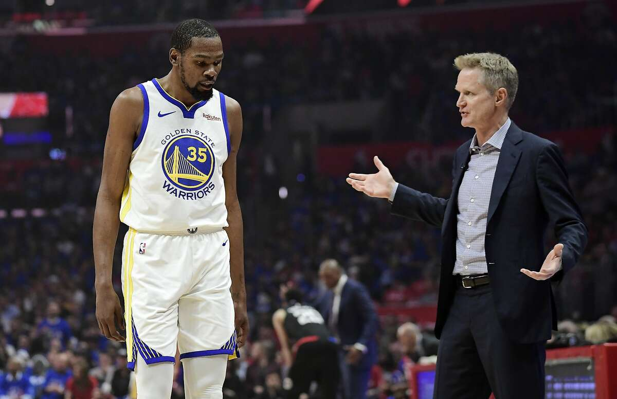 Golden State Warriors coach Steve Kerr, right, talks to forward Kevin Durant during the first half in Game 3 of the team's first-round NBA basketball playoff series against the Los Angeles Clippers on Thursday, April 18, 2019, in Los Angeles. (AP Photo/Mark J. Terrill)