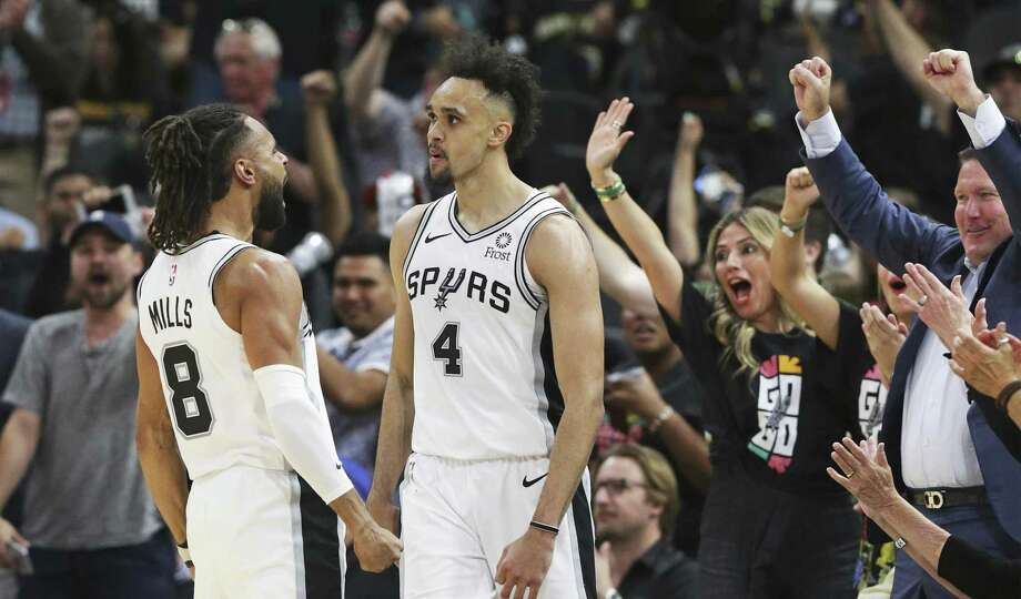 Derrick White hears screams of applause from fans and Patty Mills after a layup in the late minutes as the Spurs finished off a dramatic win over the Nuggets in Game 3 of the first round on Western Conference playoffs at the AT&T Center on April 18, 2019. Photo: Tom Reel, Staff / Staff Photographer / 2019 SAN ANTONIO EXPRESS-NEWS