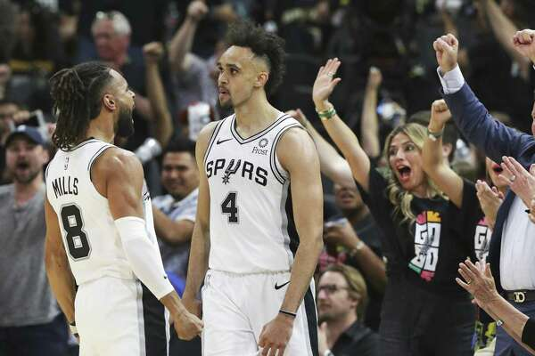 Derrick White hears screams of applause from fans and Patty Mills after a layup in the late minutes as the Spurs host the Nuggets in game 3 of the first round on Western Conference playoffs at the AT&T Center on April 18, 2019.