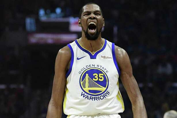 Golden State Warriors forward Kevin Durant celebrates after scoring during the first half in Game 3 of the team's first-round NBA basketball playoff series against the Los Angeles Clippers on Thursday, April 18, 2019, in Los Angeles.