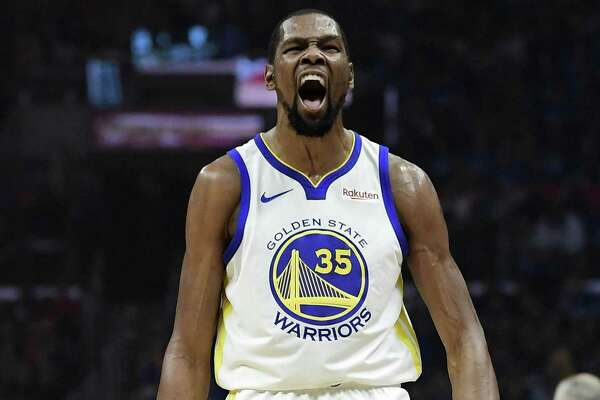 7bbd6b188348 2of10Golden State Warriors forward Kevin Durant celebrates after scoring  during the first half in Game 3 of the team s first-round NBA basketball  playoff ...