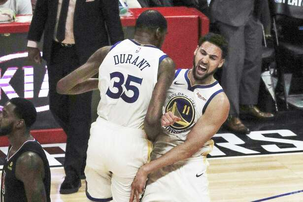 Kevin Durant and Klay Thompson showed ferocious joy after Thompson nailed a 3-pointer.