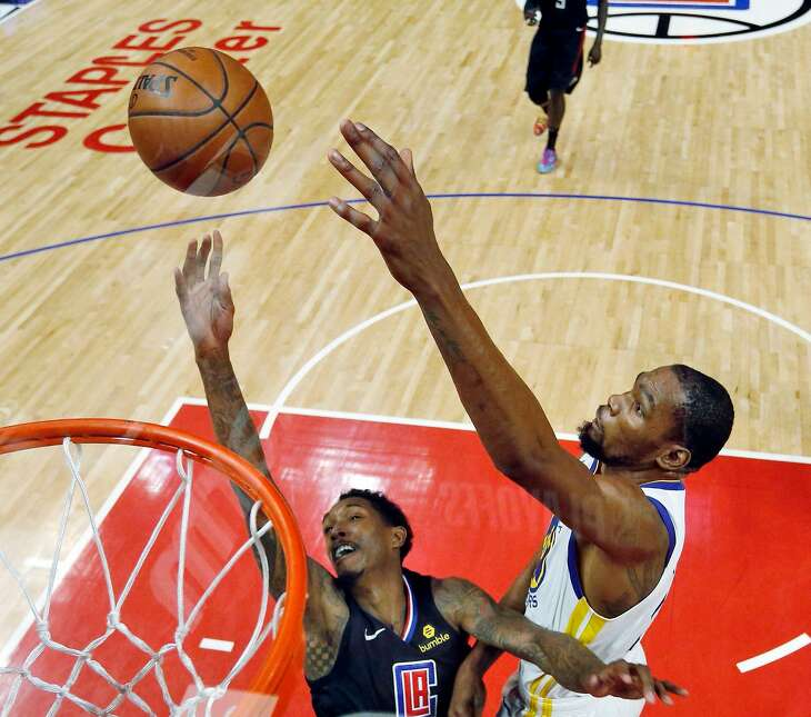 Kevin Durant (35) blocks a shot by Lou Williams (23) In the first half as the Golden State Warriors played the Los Angeles Clippers in Game 3 of the First Round of the NBA Playoffs at Staples Center in Los Angeles, Calif., on Friday, April 19, 2019.