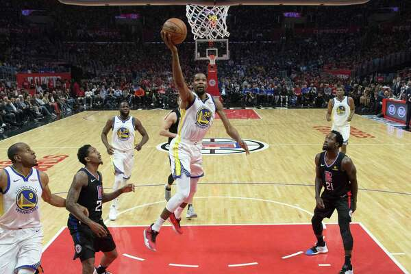 4cc2f39c5f66 1of10Kevin Durant (35) drives to the basket In the first half as the Golden  State Warriors played the Los Angeles Clippers in Game 3 of the First Round  of ...