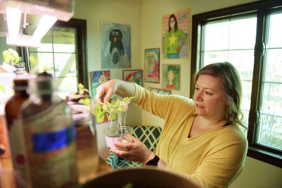 Jessica Marcy, a professional organizer who leads plastic detox seminars and has changed her family's lifestyle to use less packaging, is pictured with plastic containers which she uses to grow vegetables at her home on Thursday, April 11, 2019, in Poestenkill, N.Y. (Will Waldron/Times Union) Photo: Will Waldron / 40046601A