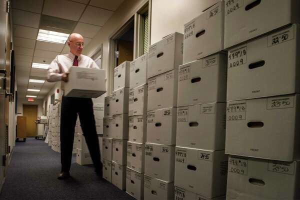 Mark Robbins, then-acting chairman of the Merit Systems Protection Board, with some of the backlogged case files on Feb. 6, 2019. His last day in office was Feb. 28.
