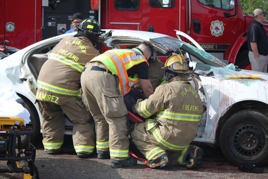 First responders work to extract student actors from a vehicle during a Shattered Dreams presentation at Plainview High School on Wednesday. Photo: Alex Driggars/Courtesy Photo