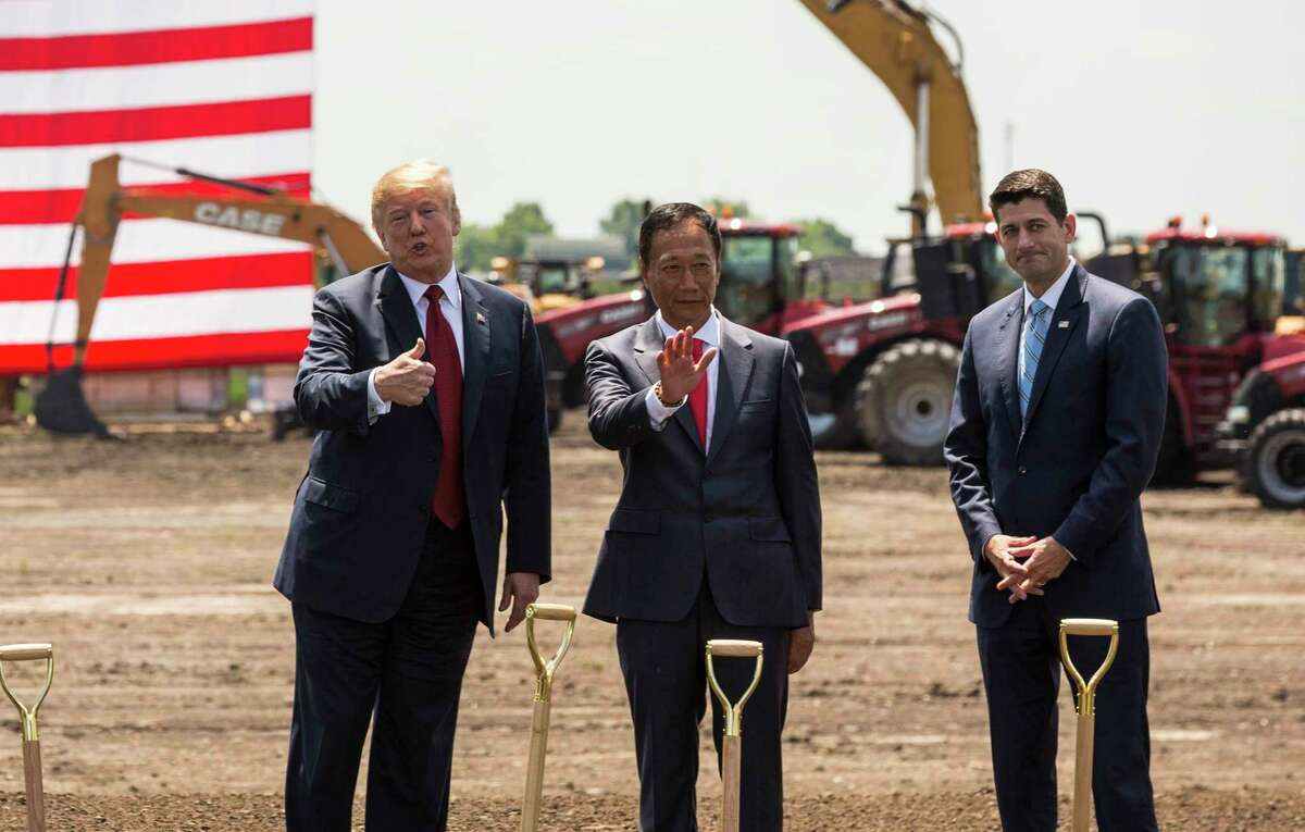 President Donald Trump (left) and Rep. Paul Ryan of Wisconsin (right) joined Foxconn founder Terry Gou at the groundbreaking of the company's Wisconsin plant last summer.