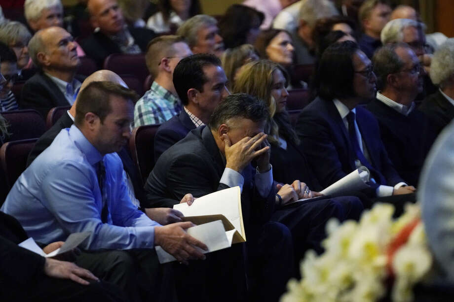 Frank DeAngelis, center, who was principal at Columbine High School during the massacre almost 20 years earlier, fights back tears Thursday during a faith-based memorial service for the victims at a community church in Littleton, Colo. Photo: Rick Wilking/Pool/via AP