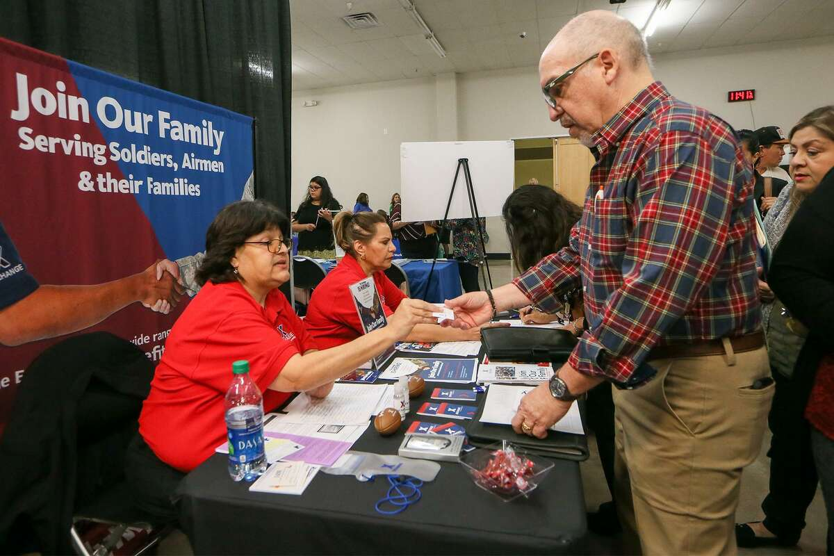 Paul Delauter, right, talks with Cindy Lopez representing the Exchange at JBSA Ft. Sam Houston, JBSA Randolph and JBSA Lackland at the Goodwill San Antonio job fair at the TriPoint Event Center, 3233 N. St. Mary's St., on Wednesday, April 3, 2019. More than fifty employers from the San Antonio area were on hand with available positions for local residents with an emphasis on veterans and individuals with disabilities. The Exchange has retail, cashier, stocker, and food service worker positions available.