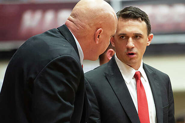 SIUE assistant coaches Brian Barone (right) and Mike Waldo talk during a break in a game last season at Vadalabene Center in Edwardsville. Barone, who spent the past two seasons as a Cougars assistant, steps up as the new head coach at SIUE