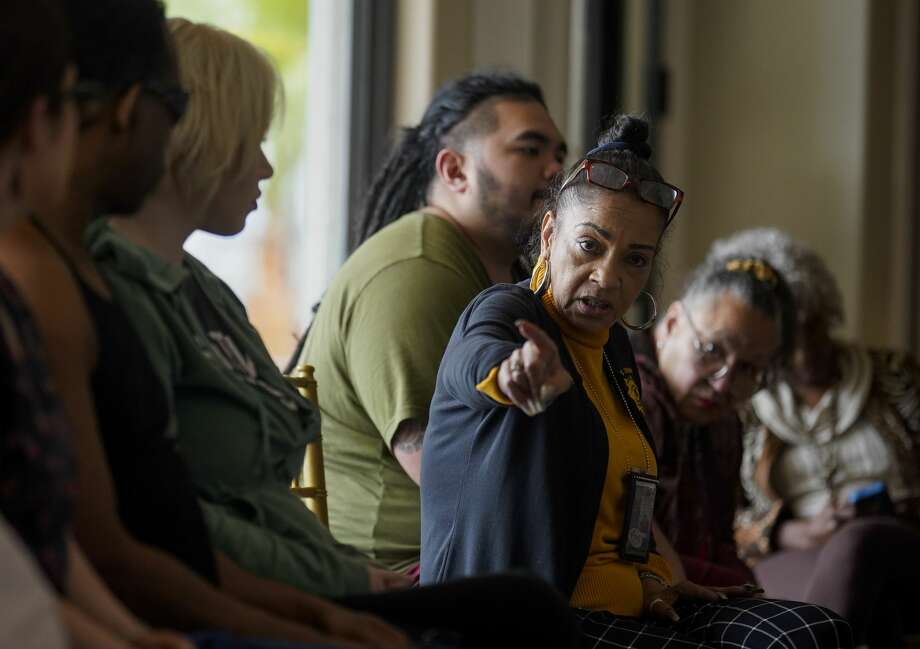 "Kathryn Griffin, center, of the Harris County Precinct 1 Constable's office, leads a support group for ex-prostitutes and sex-trafficking victims at a mansion in Houston. Griffin, 59, calls herself an ""ex-ho"" and says it took her 22 rehabs to shake her crack addiction. Photo: Godofredo A. Vásquez/Staff Photographer"