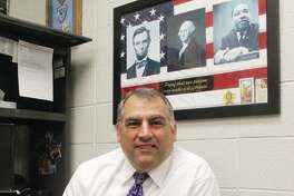Capt. T. Mike Dixon, head of investigations for the Madison County Sheriffs Department, retires Friday, April 19 after 29 years in law enforcement. He will start a new job in the private sector as an investigator for a St. Louis law firm.