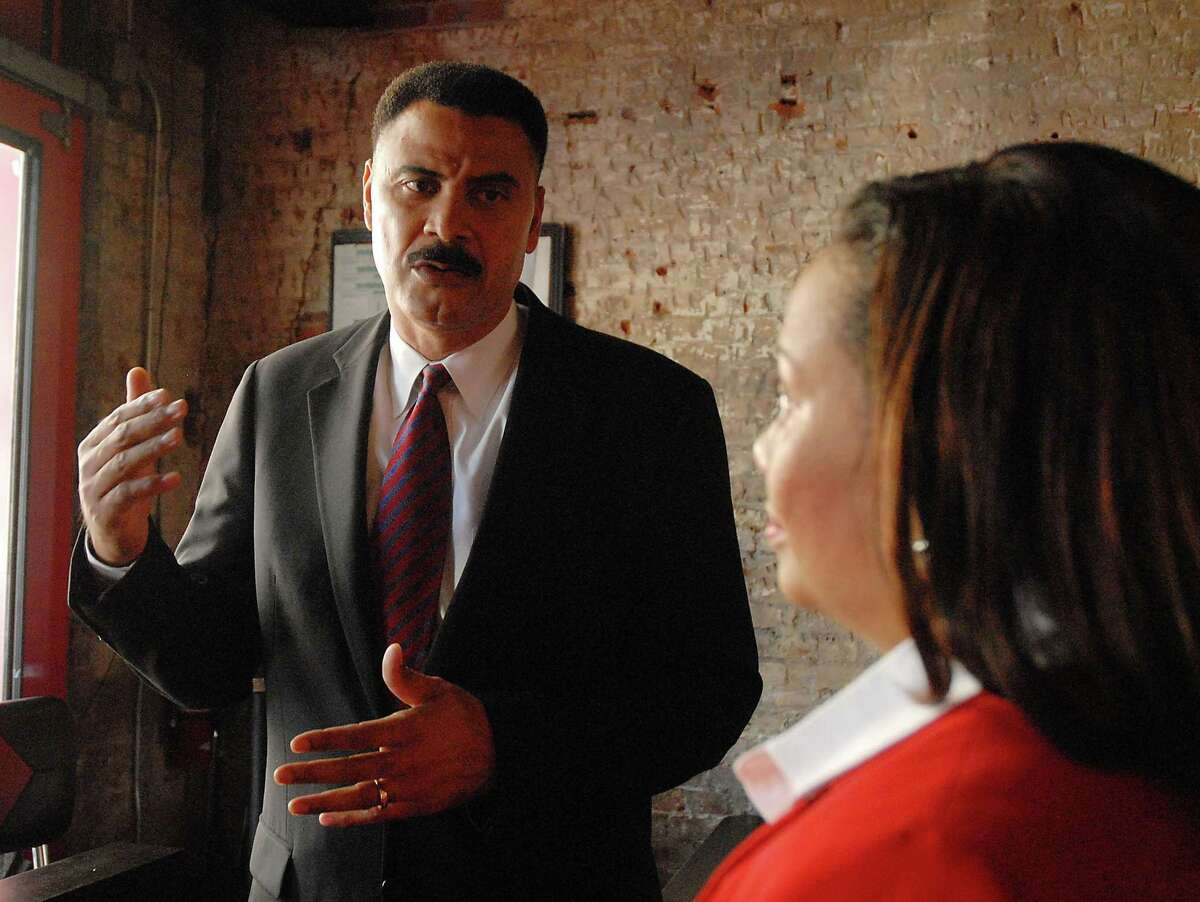 Former Houston Police Chief C.O. Bradford talks with Judge Maria Jackson at a fundraiser for Jackson at the Red Cat Jazz Cafe downtown on July 10, 2008.