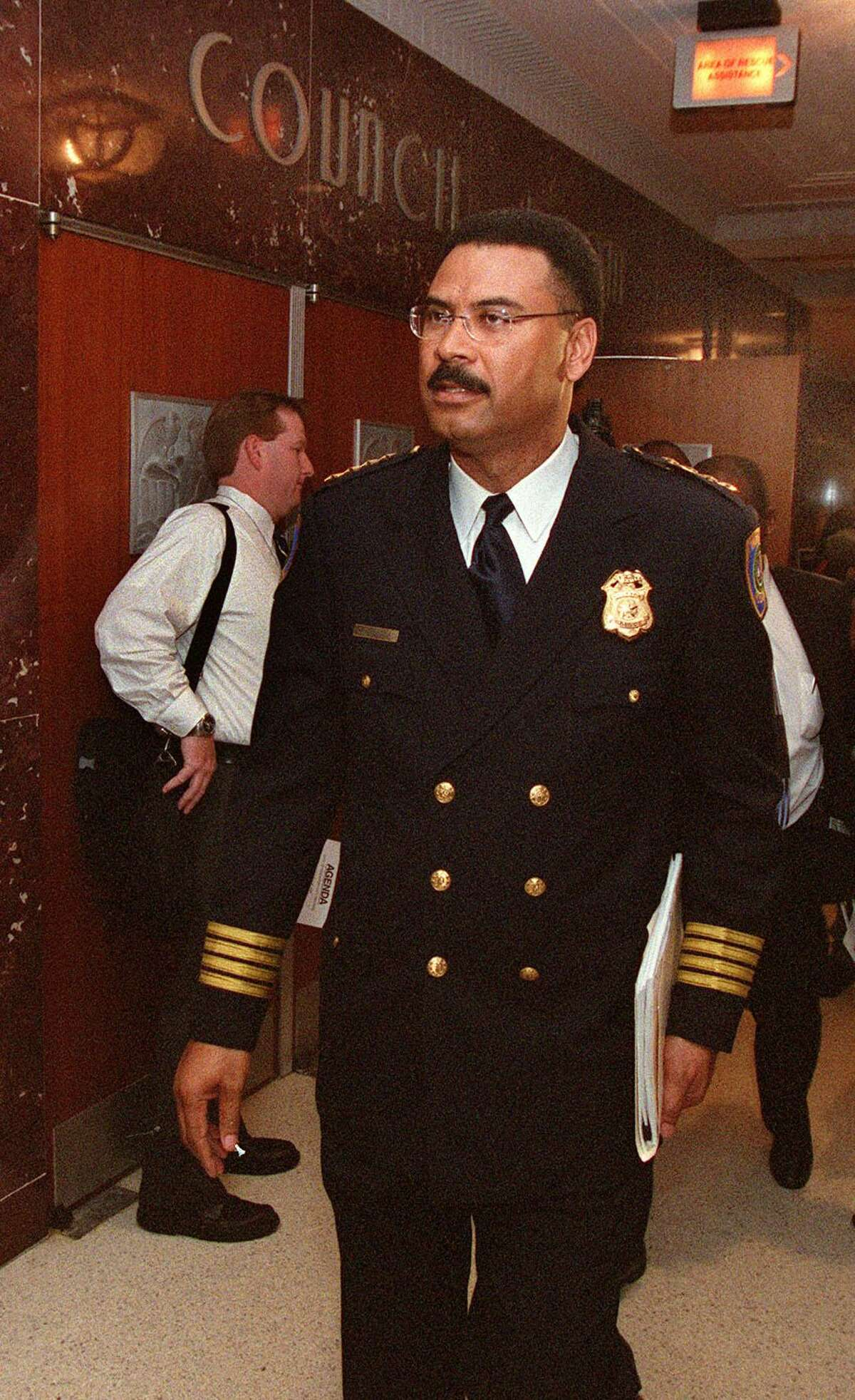 Houston Police Chief C.O. Bradford goes before the city council on June 25, 2003 to submit plans to rehabilitate the city's troubled crime lab.
