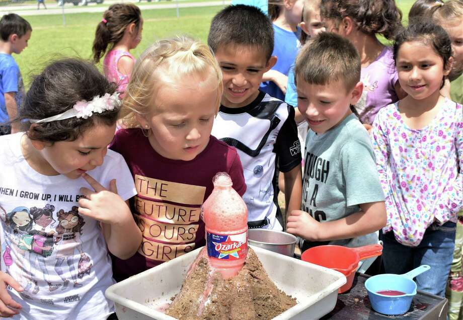 "Needville Elementary School kindergarten students check out the ""lava"" left behind after a ""volcanic eruption"" created by teachers Wendy Todd and Charlene Baker during Super Outrageous Science Day. From left are Hailey Gonzalez, Ava Karnei, Samson Alvarado, Colin Grudziecki and Camila Huerta. Photo: Needville ISD / Needville ISD"