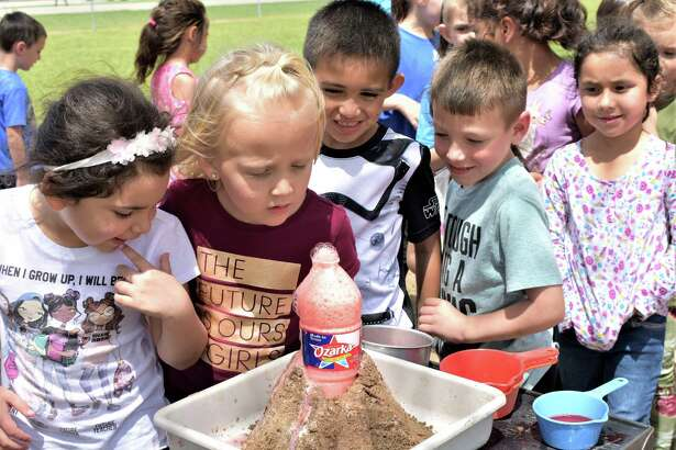 """Needville Elementary School kindergarten students check out the """"lava"""" left behind after a """"volcanic eruption"""" created by teachers Wendy Todd and Charlene Baker during Super Outrageous Science Day. From left are Hailey Gonzalez, Ava Karnei, Samson Alvarado, Colin Grudziecki and Camila Huerta."""