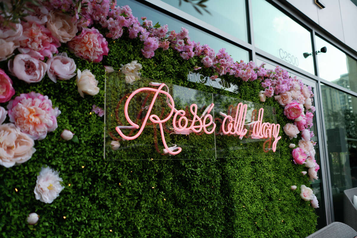 """Fig and Olive Tasting Kitchen & Bar 5115 WestheimerSeats: 40 The """"Rosé Terrace"""" at coastal Mediterranean restaurant Fig and Olive at The Galleria is pretty in pink with pastel pink pillows, a green ivy installation of pink roses and a pink neon """"Rosé All Day"""" sign."""