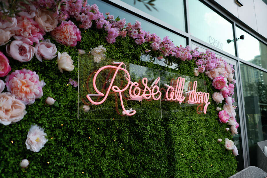 """Fig and Olive Tasting Kitchen & Bar5115 WestheimerSeats: 40  The """"Rosé Terrace"""" at coastal Mediterranean restaurant Fig and Olive at The Galleria is pretty in pink with pastel pink pillows, a green ivy installation of pink roses and a pink neon """"Rosé All Day"""" sign.  Photo: Chris Luong"""