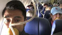"In this April 17, 2018 photo provided by Marty Martinez, Martinez appears with other passengers after a jet engine blew out on the Southwest Airlines Boeing 737 plane he was flying in from New York to Dallas, resulting in the death of a woman who was nearly sucked from a window during the flight with 149 people aboard. A preliminary examination of the blown jet engine that set off a terrifying chain of events showed evidence of ""metal fatigue,"" according to the National Transportation Safety Board."