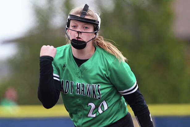Carrollton's Hannah Rhoades delivers a pitch to the plate during her three-hitter against North Greene on Thursday at Lenz Field in Jacksonville.