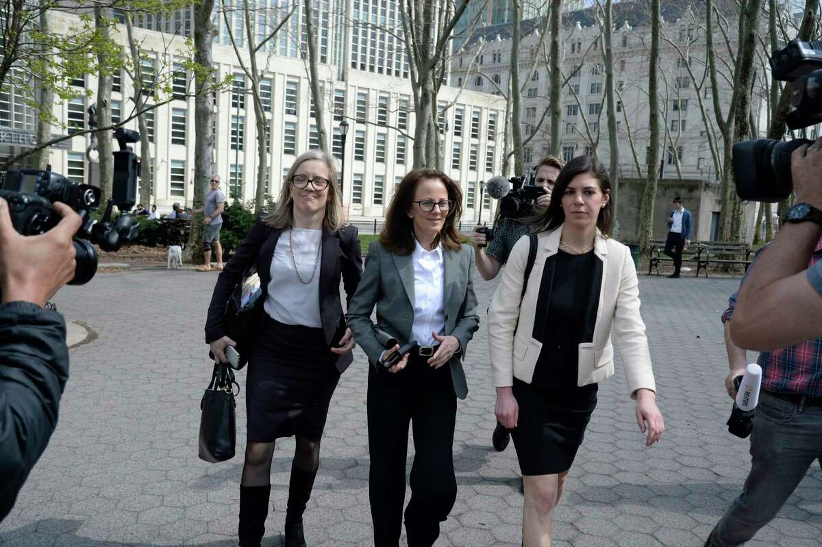 Kathy Russell, center, one of the defendants in the NXIVM sex-cult case, leaves Federal District Court in Brooklyn, April 8, 2019. Some women in the organization were part of a secret society in which they were branded with the initials of NXIVM's former leader, Keith Raniere, and forced to have sex with him, federal prosecutors have said.