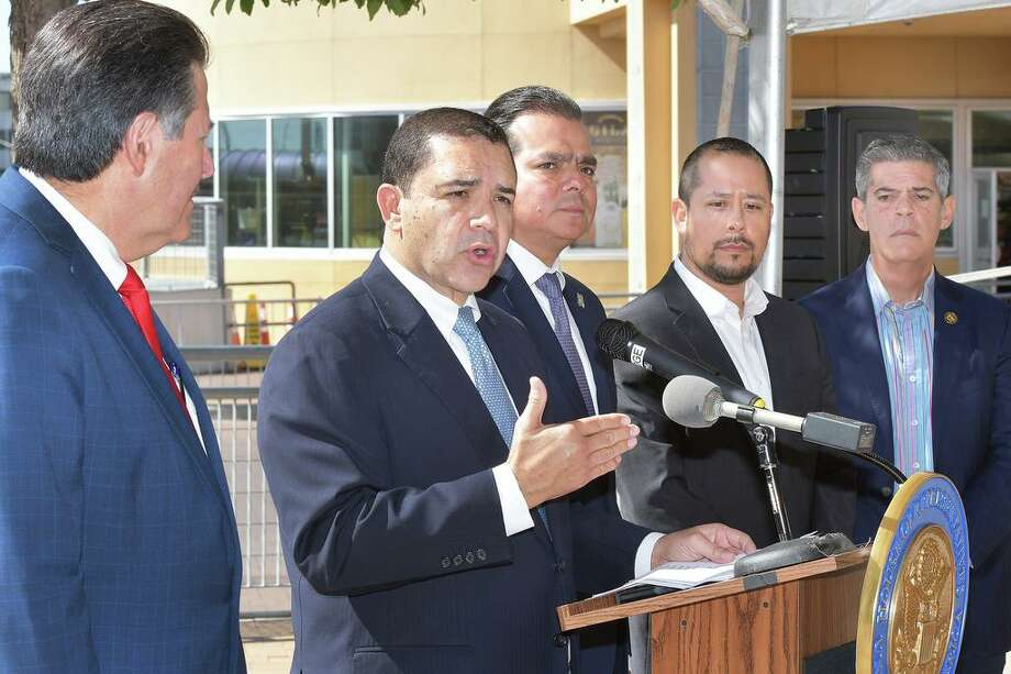 Officials from Laredo and Nuevo Laredo held a news conference Thursday at the Gateway to the Americas Bridge to provide an update on delays at the ports of entry. Pictured at the conference are, from left, Laredo Mayor Pete Saenz, U.S. Congressman Henry Cuellar, Nuevo Laredo Mayor Enrique Rivas Cuellar, Jerry Maldonado, of the Laredo Motor Carriers Association, and Dionisio Gonzalez de Castilla, of the Association of Logistics and Forwarding Agents. Photo: Cuate Santos/Laredo Morning Times