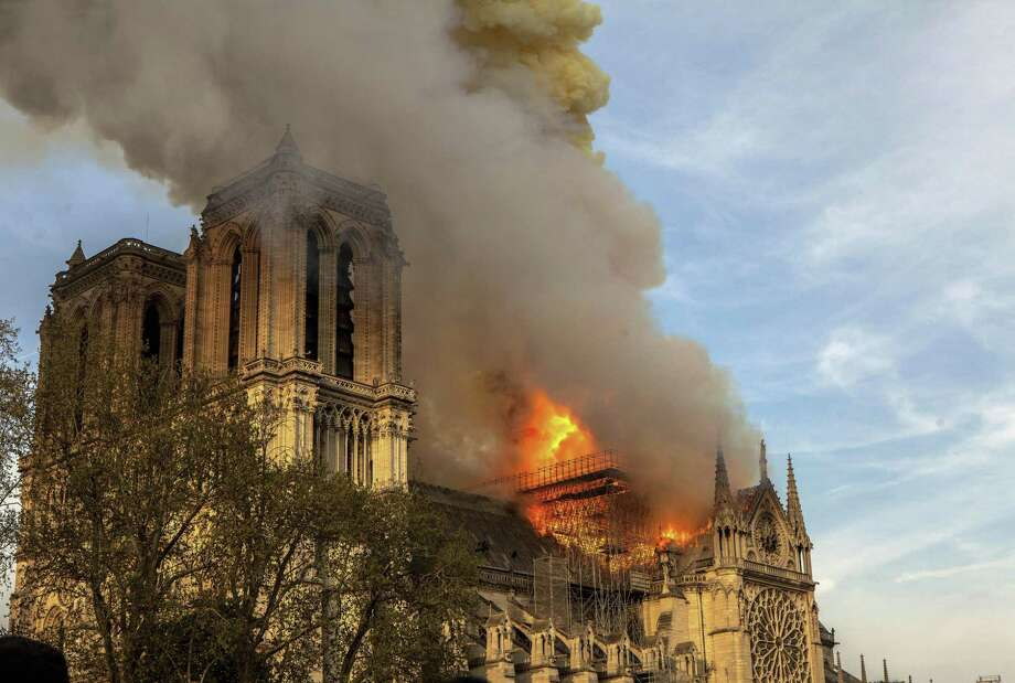 This photo taken on Monday April 15, 2019 shows Notre Dame cathedral burning in Paris. Firefighters declared success Tuesday April 16, 2019 morning in an over 12-hour battle to extinguish an inferno engulfing Paris' iconic Notre Dame cathedral that claimed its spire and roof, but spared its bell towers. (AP Photo/Vanessa Pena) Photo: Vanessa Pena / Associated Press / Copyright 2019 The Associated Press. All rights reserved.