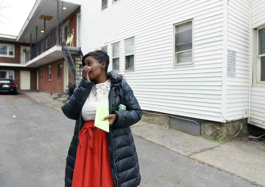 Tiana Logan reacts to receiving a check donated by an anonymous reader on Thursday, April 18, 2019 at the Logan's old apartment on Hamilton Street in Albany, NY. (Phoebe Sheehan/Times Union) Photo: Phoebe Sheehan, Albany Times Union / 40046721A