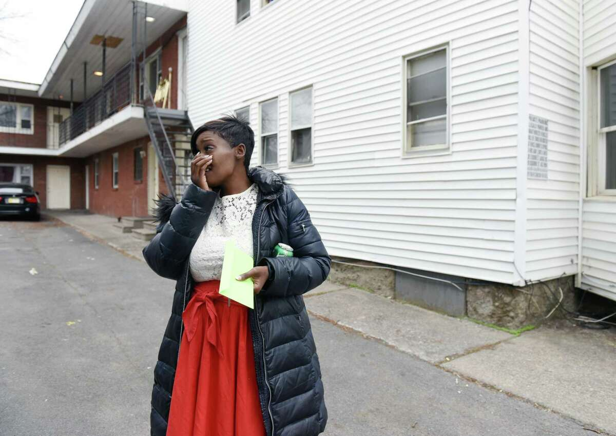 Tiana Logan reacts to receiving a check donated by an anonymous reader on Thursday, April 18, 2019 at the Logan's old apartment on Hamilton Street in Albany, NY. (Phoebe Sheehan/Times Union)