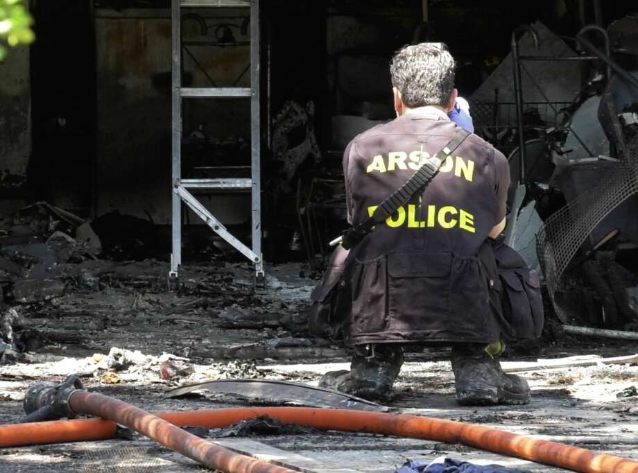 Houston Fire Department arson investigators work to determine the cause of a fire in the 9900 block of Valley Wind Drive on Friday, April 19, 2019. Early reports indicate a woman set herself on fire. Photo: Jay R. Jordan