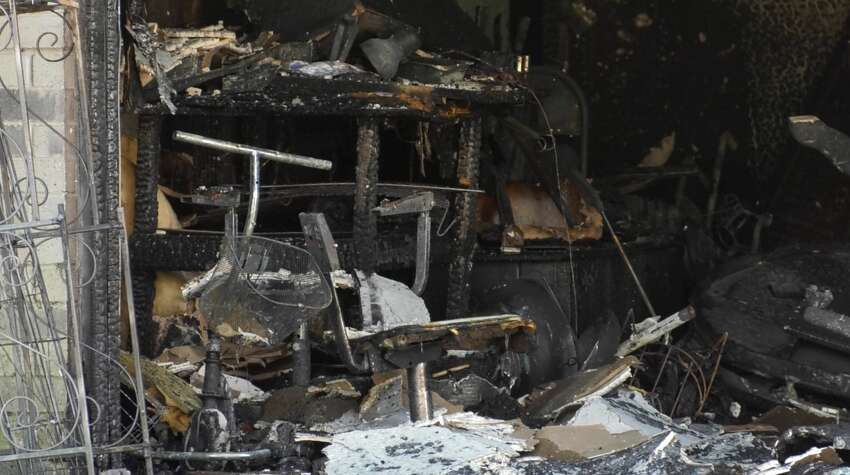 Houston Fire Department arson investigators work to determine the cause of a fire in the 9900 block of Valley Wind Drive on Friday, April 19, 2019. Early reports indicate a woman set herself on fire.