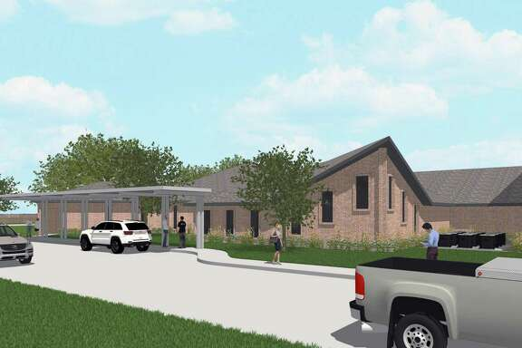 This is a sidewalk level view of the chapel addition to the fellowship building at Church of Christ in Katy.