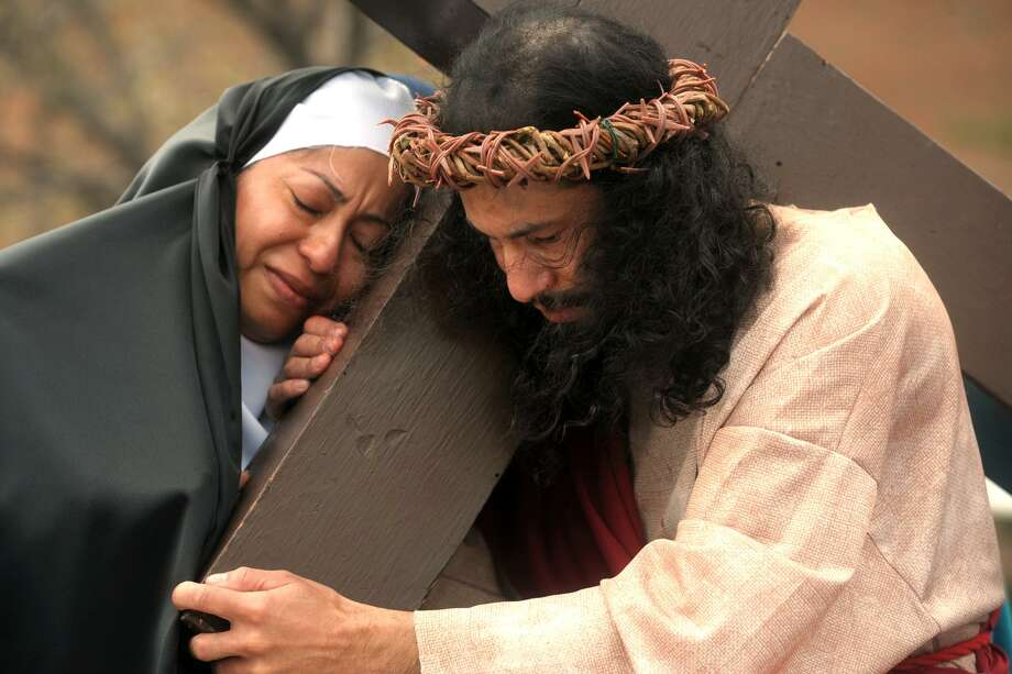 Portraying Jesus Christ and Mary, Itamar Santos and Griselda Contreras take part in the annual Living Stations of the Cross procession through Bridgeport's East Side on Good Friday, April 19, 2019. Photo: Ned Gerard / Hearst Connecticut Media / Connecticut Post