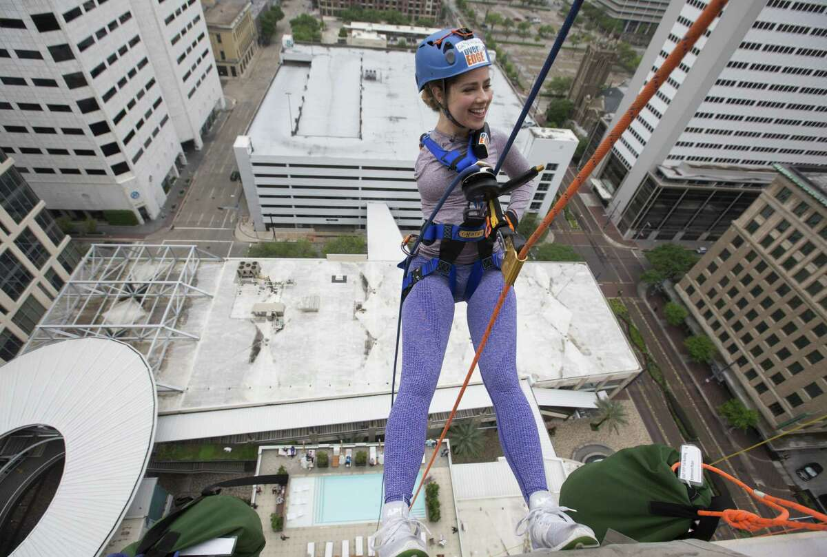 Faith Malton is excited to propel down from the 21st floor of Hotel Alessandra on Saturday, April 13, 2019, in Houston. The 22-year-old University of Houston student was born with one arm and participated in the annual fundraiser to raise money for Camp For All.